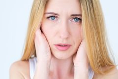 Emotion face sad worried upset concerned woman stock photography
