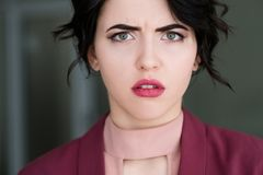 Emotion face sad worried upset concerned woman royalty free stock photography