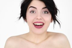 Emotion face smiling surprised joyful woman. Emotion face. amazed happy smiling surprised joyful jolly amused woman. young beautiful brunette girl portrait on stock image