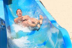 Emotion of fear and delight on a roller coaster at the water park