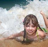 Emotion girl at sea coast. Royalty Free Stock Images