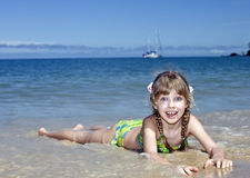 Emotion girl at sea coast. Royalty Free Stock Image