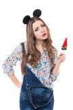 Emotion girl in studio looking at the camera with lollipop Stock Photo
