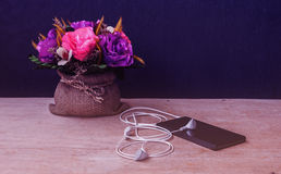 Emotion of relax, Smartphone with earphone and flower, Vintage a Royalty Free Stock Images