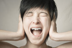 Emotion scream. Loud screaming woman with wide opened mouth Royalty Free Stock Image