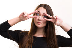 Emotion series of young and beautiful ukrainian girl - fooling around. The girl has green eyes and brown hair royalty free stock photography