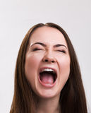 Emotion series of young and beautiful ukrainian girl - loud screaming Stock Photo