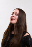 Emotion series of young and beautiful ukrainian girl - tongue licking lips Stock Photos