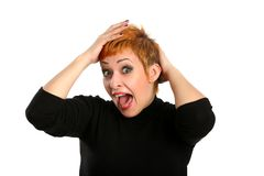 Emotion of surprise. On a girl's face with red hair Stock Photo