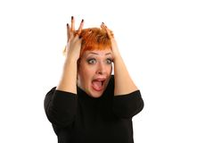Emotion of surprise. On a girl's face with red hair Royalty Free Stock Photography