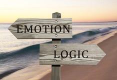 Emotion versus logic. Opposite direction sign Stock Photo
