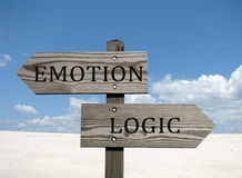 Emotion versus logic. Opposite direction sign. Blue sky background Royalty Free Stock Photo
