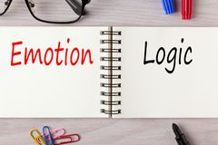 Emotion or Logic. Emotion vs Logic written on notebook with marker pen. Business Concept royalty free stock image