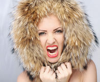 Emotion woman. Portrait of emotion woman with fur Stock Photos