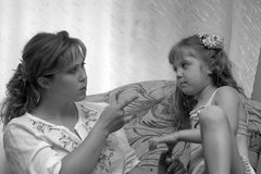 Emotional. Mother abuses the daughter for a fault Royalty Free Stock Photography