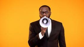 Emotional african-american manager shouting to loudspeaker, discipline, deadline stock photography