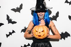 Emotional amazing young woman in witch halloween costume Stock Photos