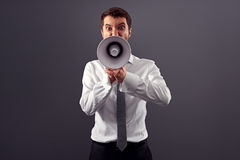 Emotional angry man shouting with megaphone Royalty Free Stock Photo
