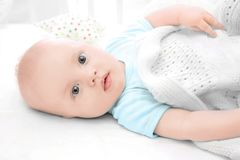 Emotional baby lying in cradle. Insomnia and sleep. Disorders concept Stock Image