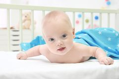 Emotional baby lying in cradle. Insomnia and sleep. Disorders concept Royalty Free Stock Photo