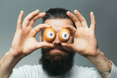 Emotional bearded man with egg eyes Royalty Free Stock Photography