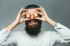 Emotional bearded man with egg eyes Stock Photos