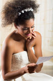 Emotional beautiful bride reading a love letter Royalty Free Stock Photography