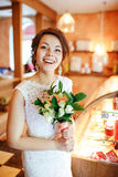 Emotional beautiful bride with wedding bouquet in interior, joyful surprised face, facial expression. Royalty Free Stock Image