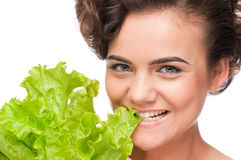 Emotional beauty woman with green lettuce Royalty Free Stock Photo