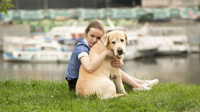 Emotional black and white portrait of a sad lonely girl hugging her dog. Emotional black and white portrait of a sad lonely girl hugging her retriever dog Royalty Free Stock Photo