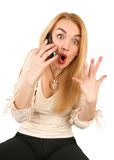 Emotional blond woman with phone. Very emotional blond woman with phone Royalty Free Stock Photo