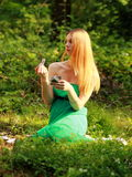 Emotional blonde, play cards, looking left. Royalty Free Stock Images
