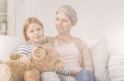 Emotional bond with cancer mother. Emotional bond between daughter and mother with malignant cancer Stock Photo