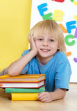 Emotional boy with books Royalty Free Stock Photography