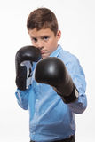 Emotional boy brunette in a blue shirt with boxing gloves in hands Stock Image
