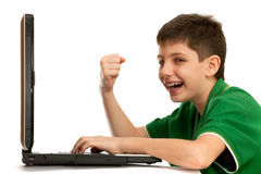 Emotional boy is playing computer game Royalty Free Stock Images