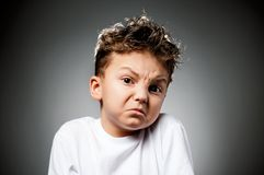 Emotional boy Stock Images