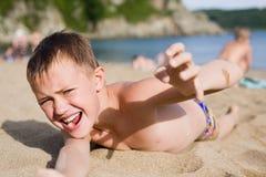 Emotional boy on the beach. Emotional boy resting on the beach Stock Photo