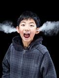 Emotional Boy with Steam Coming From Ears Stock Photos