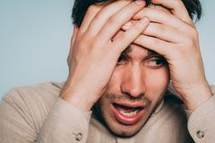 Emotional breakdown desperate man distress emotion. Emotional breakdown. desperate man in distress. failure and loss concept. portrait of a young brunet guy on stock photography