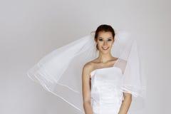 Emotional bride. In white wedding dress Stock Image