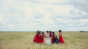 Emotional bride and bridesmaids talking and laughing. Slow motion. stock video