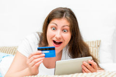 Emotional brunette with credit card Stock Photos
