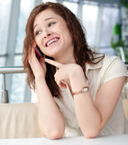 Emotional Business woman with phone at cafe Royalty Free Stock Photography