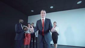 Emotional businessman gesturing at camera stock footage