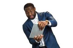 Emotional businessman plays computer game. stock image