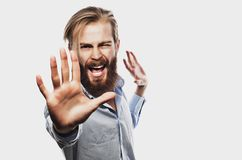 Emotional businessman pulls his hands apart, expressing surprise and disappointment. Business concept. Stock Photography