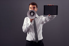 Businessman with tablet pc and megaphone Royalty Free Stock Images