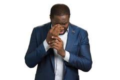 Emotional businessman wipe his eye. Stock Images