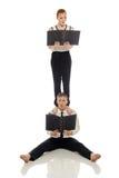 Emotional businessmen-acrobats posing at camera Stock Image